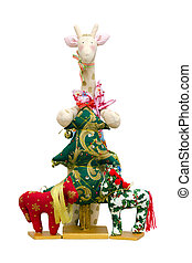 The Handmade soft toy isolated New Year tree and giraffe and...