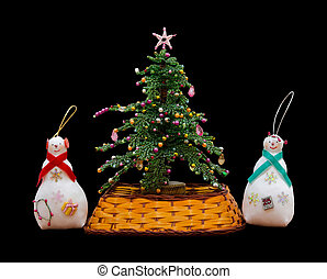 Handmade isolated New Year tree and 2 snowmans - The...