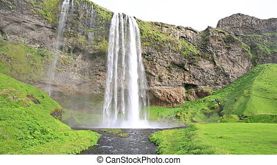 Seljalandsfoss waterfall - Wide angle view of Seljalandsfoss...