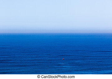 Blue Ocean Blue Sky - Overlooking blue ocean towards blue...