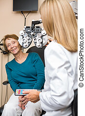 Smiling Senior Woman Undergoing Eye Checkup - Smiling senior...