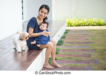Mother is Raising children and dogs together - Raising...