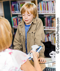 Schoolboy Waiting At Checkout Counter - Schoolboy waiting...