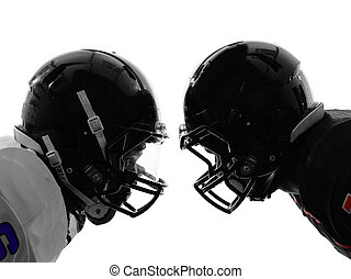 two american football players face to face silhouette - two...