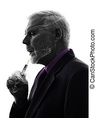 senior business man smoking electronic e-cigarette...