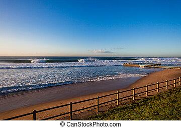 Ocean Beach Tidal Pool Waves - Beach tidal pool with morning...