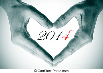 2014, as the new year - man hands forming a heart and the...
