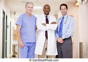 Doctors Standing In A Hospital Corridor