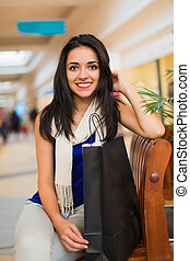 Women Love Being in Malls - Pretty young lady in blue...