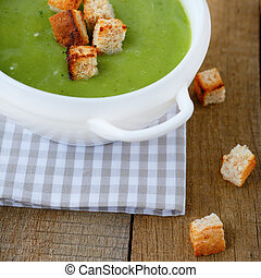 green cream soup with croutons, food