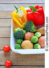 raw vegetables and cooking utensils