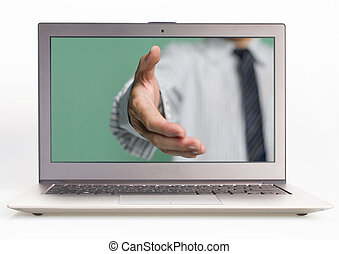 Business man hand reaching out from screen to shake