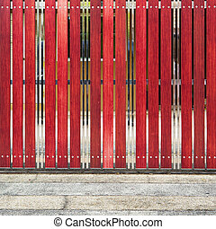 red painted wooden fence panels