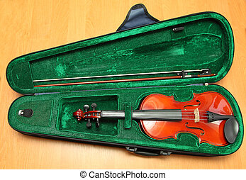violin in the case of green