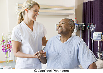 Nurse Helping Patient Sit Up In Bed