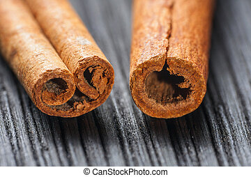 cinnamon on the wooden background