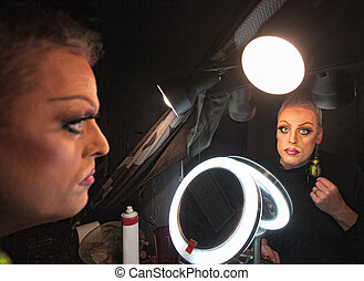 Serious Drag Queen - Serious drag queen in front of mirror...