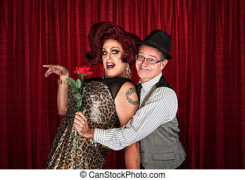 Man Holding Drag Queen - Man in hat attracted to drag queen