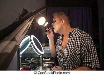 Man Using Lipstick Pencil - Serious male drag queen...