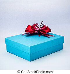 blue gift box with red ribbon on isolated white background