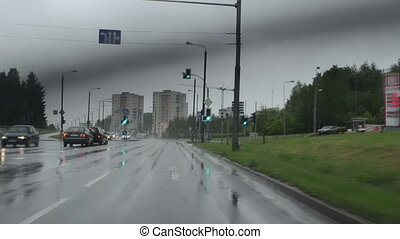 rain fall car highway - cars drive on urban city road and...