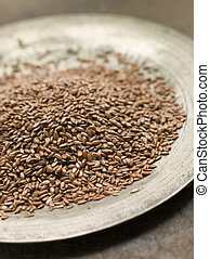 Brown Linseed on a Pewter Plate