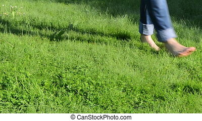 barefoot girl grass dew - Bare foot girl woman with tucked...