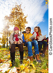 Three kids sketching autumn
