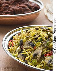 Dish of Mushroom Pilau Rice with Beef Madras