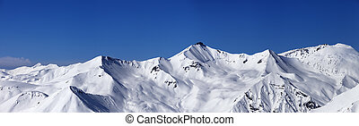 Panoramic view on off-piste slopes and blue sky at nice day....