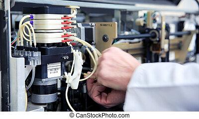 Preparing laboratory equipment - Male technician preparing...