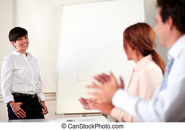 Charming young businesswoman giving a presentation
