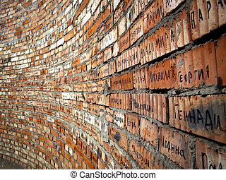 Brick wall with cyrillic names