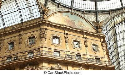 Galleria Vittorio Emanuele in Milan, with people walking....