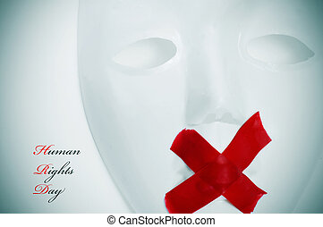 human rights day - a white mask with its mouth shut with red...
