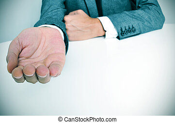 man in suit with an outstretched hand - man wearing a suit...