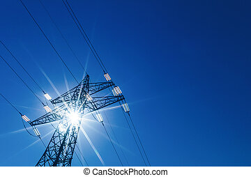 power pole and sun - through a mast of a high voltage cable...