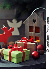 Christmas decorations with gift box and lantern on wooden...