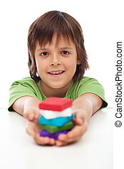Young boy with colorful clay blocks in his hand