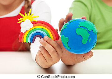 Environmental awareness and education concept - child hands...