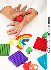 Child playing with colorful clay - closeup on hands - Child...
