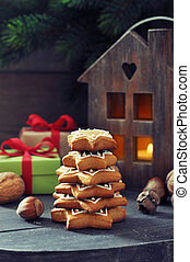 Fir tree from ginger biscuits with lantern and gift boxes on...