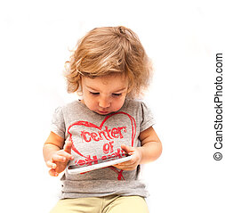 Little girl playing with smartphone on white background