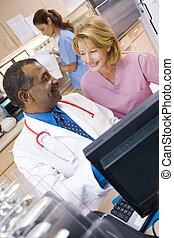 A Doctor And Nurse Discussing Something At The Reception Area Of A Hospital