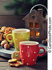 Hot chocolate with ginger cookies - Two cups of hot...