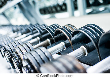 Sports dumbbells in modern sports club. Weight Training...
