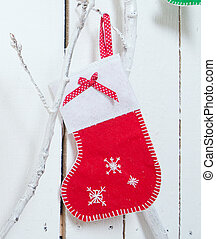 Christmas sock for gifts on the wall