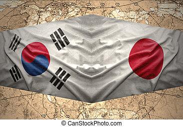 Japan and South Korea - Waving Japanese and South Korea...