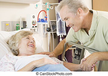 Mother And Son Laughing Together In Hospital