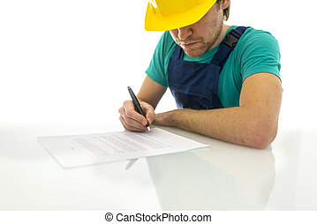 Construction worker signing contract - Young construction...